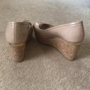 Nude patent leather cork wedge by Jimmy Choo